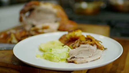 slow-roast-shoulder-of-pork-with-roasties-and-apple-sauce-with-hispi-cabbage