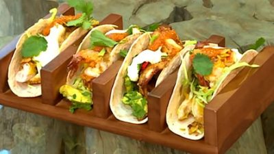 Prawn and chicken tacos with avocados, tomato mole and mango salsa