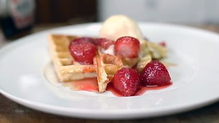 Waffles with strawberry compôte and ice cream