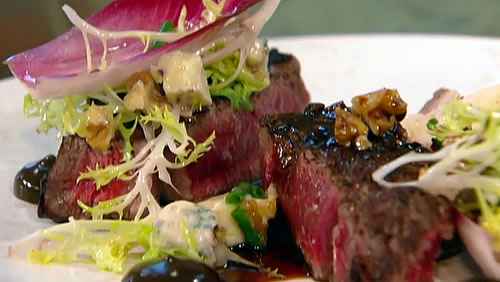 Beef fillet with chicory and blue cheese salad and celeriac chips