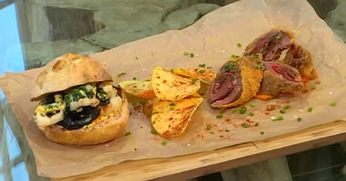 Flamenquín de cerdo Ibérico with romesco sauce, calamari and aioli