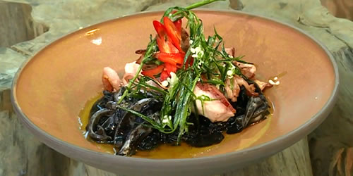 Rabbit with squid ink risotto and crispy garnish