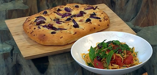 Pasta puttanesca with garlic and red onion focaccia