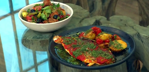 Harissa baked sea bass with baby potatoes, mint salsa and Mediterranean salad