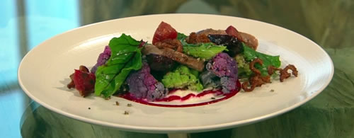 Pan-fried duck breast with a Moroccan cauliflower salad, duck scratchings and a beetroot dressing