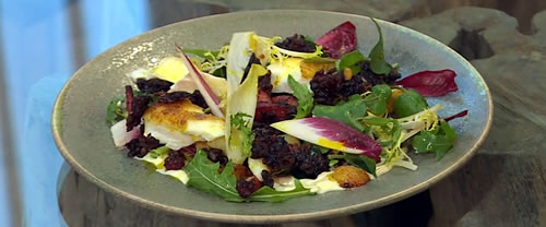 Warm salad of black pudding, potatoes and bacon with curried haddock