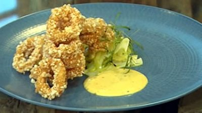 Crispy pork covered squid with fennel salad and mustard mayonnaise