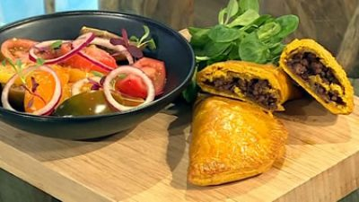 Jamaican beef patties with ginger, tomato and orange salad
