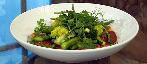 Pan-fried gnocchi with spring vegetables and basil oil