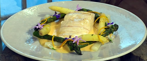 Braised halibut with maltaise sauce and asparagus