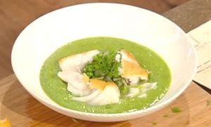 Pea soup topped with roasted salt cod