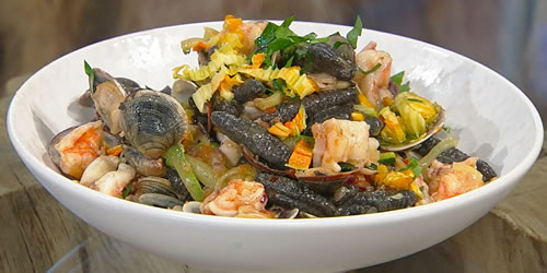 Black cavatelli with clams, prawns and courgettes
