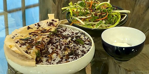 Seafood biryani with crunchy salad and masala raita