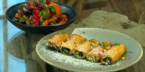 Spinach borek pastries with tomato and mint salad