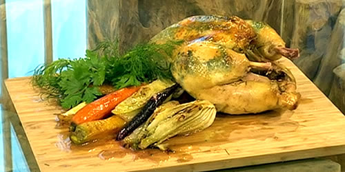 Pot roasted chicken in hay with carrots and fennel