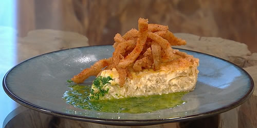 Warm onion tart with crispy tripe and parsley dressing