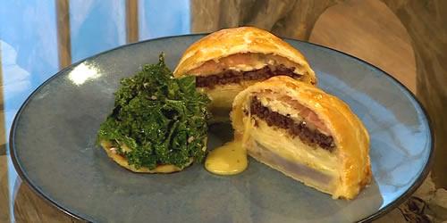 Potato, artichoke, black pudding and brie torte with sautéed kale