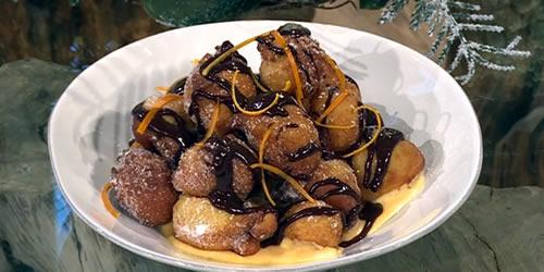 Rum and orange doughnuts with chocolate sauce and orange custard