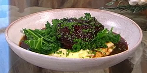 Slow-cooked ox cheek with kale and mashed potato