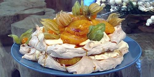 Muscovado pavlova with caramel oranges and cardamom custard