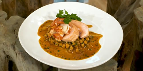 Butter poached salmon with lobster sauce, chickpeas and coriander