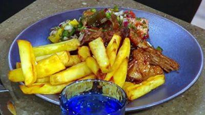 Pork carnitas with sweet potato fries and pico de gallo