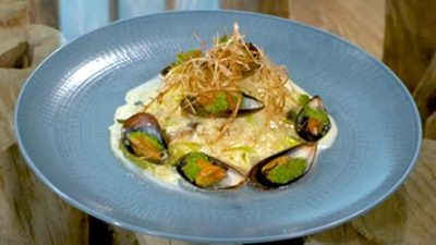 Roasted hake and grilled mussels with leek and onion sauce