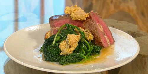 Carpetbag steak with potato cake and greens