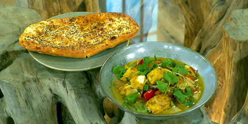 Fish curry with paneer stuffed naan bread