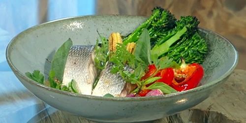 Steamed sea bass with griddled vegetables in a red curry sauce