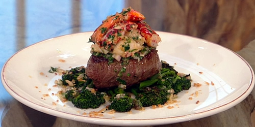 Fillet steak with lobster tail, anchovy and tarragon dressing and crispy shallots