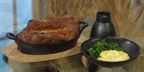Toad in the hole with onion gravy and mash potato