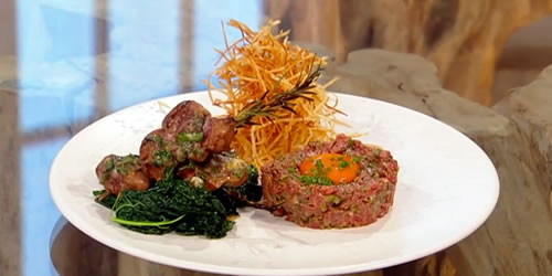 Steak tartare with shoestring fries, kidney and cavolo nero