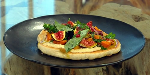 Flatbread with hummus, purple-sprouting broccoli, basil and pomegranate dressing