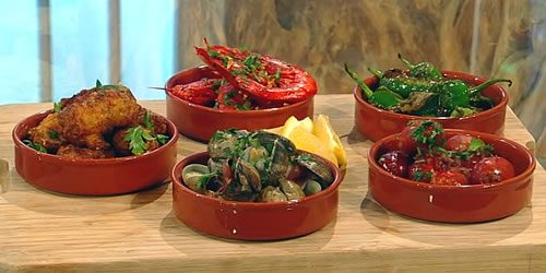 Angelas-tapas-–-prawns-cod-fritters-clams-padron-peppers-and-chorizo.jpg
